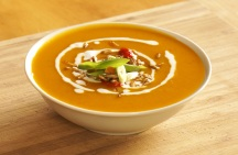 Coconut cream drizzled over the warming carrot & kumera soup.